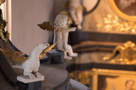 Sculptures of Angels and Eagles in White and Gold in Baroque Church Stock Photo