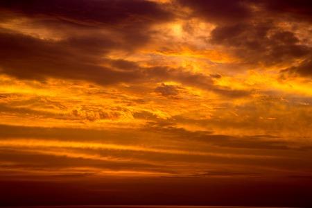 Cloudy Orange Sky at Sunset Stock Photo