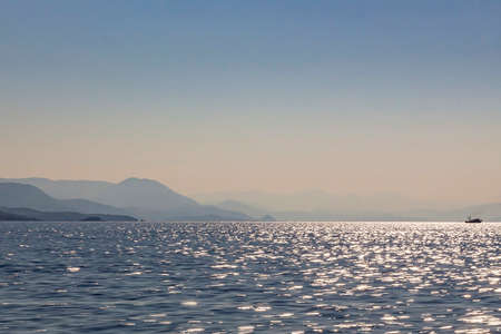 View from sea on the hilly coasts of Albania and Greece in many blue-gray color nuances, Greece 스톡 콘텐츠