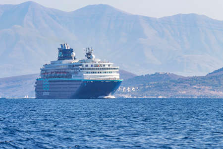 A huge cruise ship in the Strait between Albania and Corfu, Greece