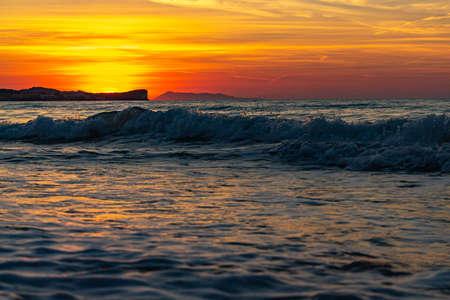 The setting sun turns the sky orange-red at Acharavi, Corfu, Greece Reklamní fotografie