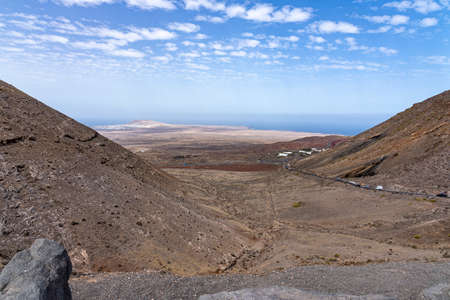 From the mountains near Femes, you have a beautiful view of the seaside village Playa Blanca, Lanzarote, Spain