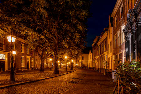 A typical Dutch street (The Hooglandse Kerkgracht), with old buildings and beautiful, lighted lamp posts, Leiden, the Netherlands 2