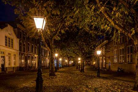A typical Dutch street (The Hooglandse Kerkgracht), with old buildings and beautiful, lighted lamp posts, Leiden, the Netherlands 3