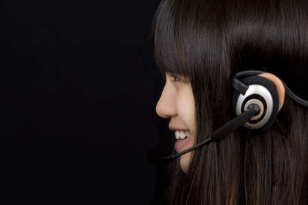 Teenager communicates by means of headset Stock Photo - 2583037