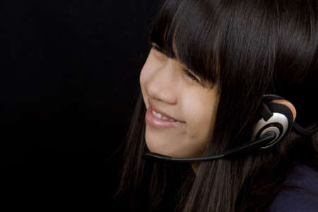 communicates: Teenager communicates by means of headset Stock Photo