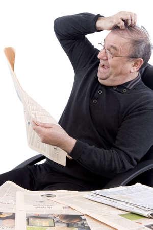news values: Pensioner reads Newspaper