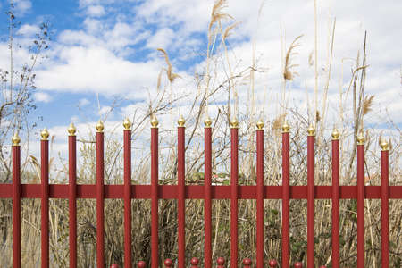 delineation: Red iron fence Stock Photo