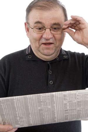 news values: Senior reads newspaper