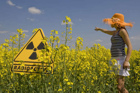 rapeoil: rape field with sign radio-active Stock Photo