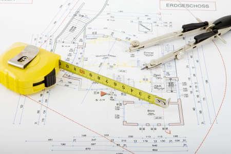 Bouw plan met een paar van kompassen en rolling meter