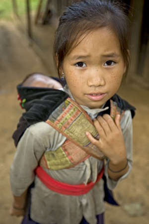 Hmong girl with brother, Laos photo
