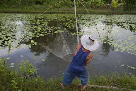 Fisherman with stave, Asia Stock Photo - 3571120