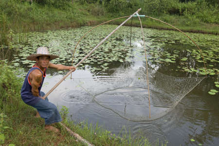 Fisherman with stave, Asia Stock Photo - 3571122