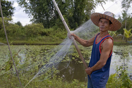 Fisherman with stave, Asia Stock Photo - 3571118