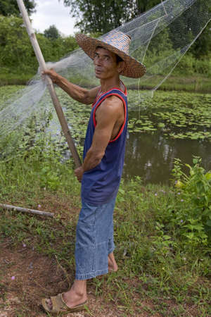 Fisherman with stave, Asia Stock Photo - 3571121