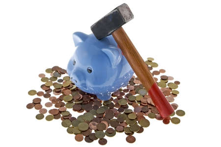 economizing: Hammer crush piggy bank to fetch the nest egg