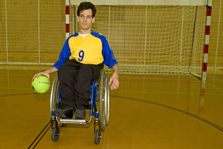 impediment: Handicapped person sport handball in the wheelchair