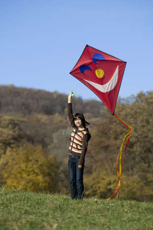 fly a kite, teenager in fall weather in nature Stock Photo - 3798201