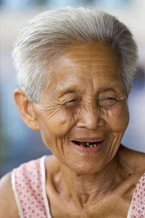 vigorously: Portrait of an old Asian, woman of Thailand Stock Photo