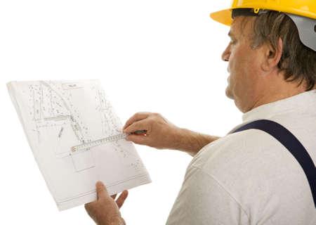 Bouwvakker met een plan van een architect