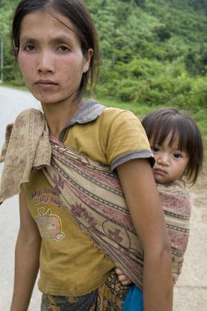 pursued: Portrait Hmong woman with baby Stock Photo