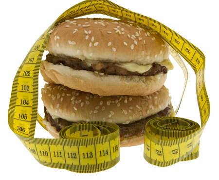 rearrangement: Fast food, Hamburger with measuring tape Stock Photo