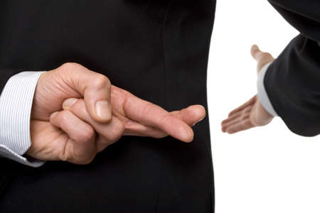 implausible: crossed fingers at handshake