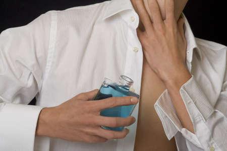 eau de perfume: Man with perfume bottle