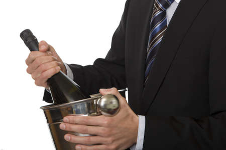 Man with suit champagne bottle in ice-pail photo