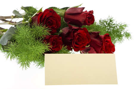 love proof: red roses with a cream-colored place card