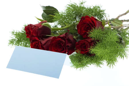 love proof: red roses with a blue place card
