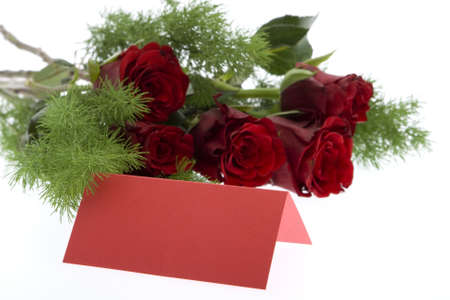 love proof: red roses with a red place card Stock Photo