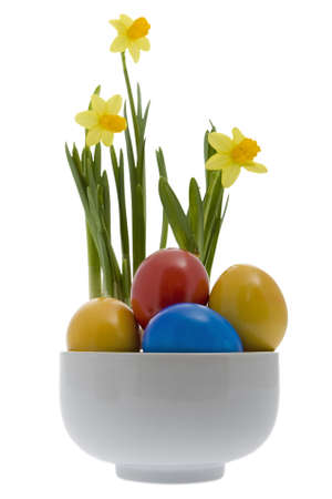 customs and celebrations: Easter eggs with yellow narcissus Stock Photo