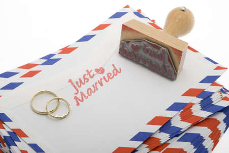 just married, announcement with a stamp on envelope photo