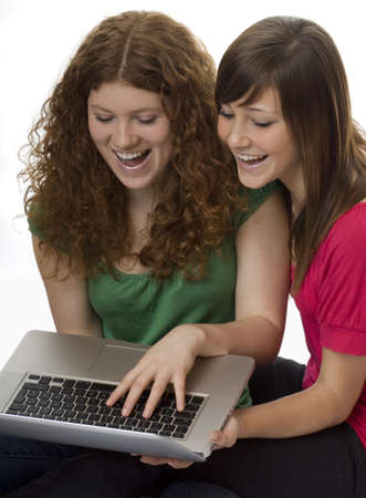 Two teenagers with laptop computer Stock Photo - 4420386