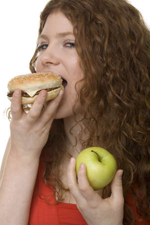 rearrangement: Fastfood or apple, female teenager with red hair choose food