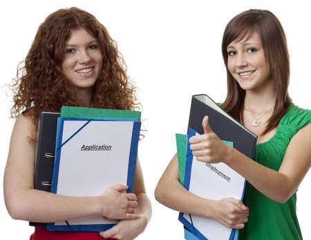 Two teenager with application briefcase photo