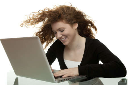 red haired teenager with laptop photo