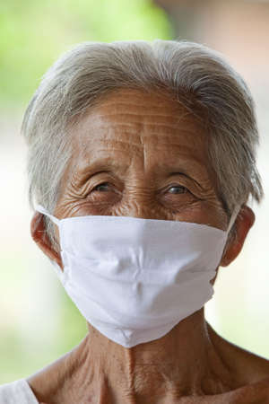 protective mask: old Asian woman with protective mask Stock Photo