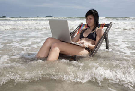 Vacation with laptop, communicate with Internet on the beach Stock Photo - 5505573