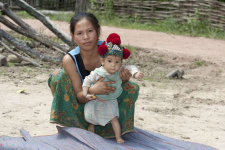 ethnic group: Laos, Asian mother with baby of the ethnic group Yao Stock Photo