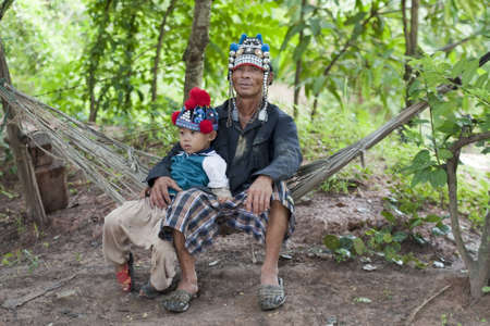 disengage: Man with child of Asia on hammock