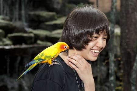 female teenager with sun conure photo
