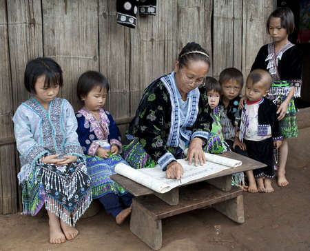 Lessons with children ethnic group Meo, Asia Stock Photo