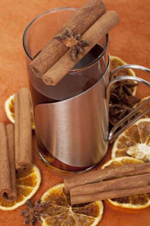 mulled wine, hot drink with cinnamon stick and spices photo