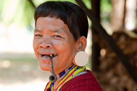 ethnic group: old woman with pipe in Asia, ethnic group Lawae in Laos