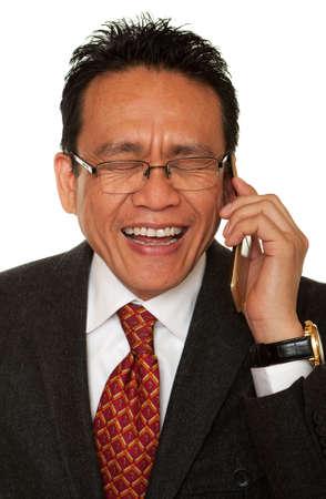 Businessman laughs while phone photo