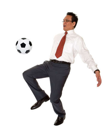 fanatic studio: Businessman plays soccer
