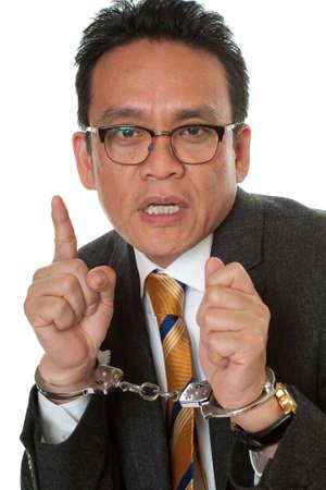 Businessman with handcuffs photo